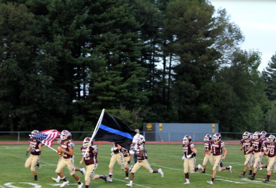 The team storms the field to kick off their home opener against Worcester North on September 7. The T-Hawks won 32-0.