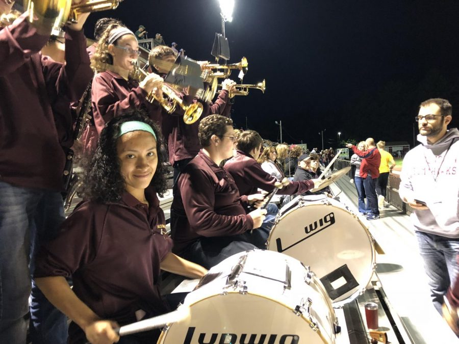 Sophomore Nicole Castilla- Villamil sits in the front row as she plays the drums in the pep band.