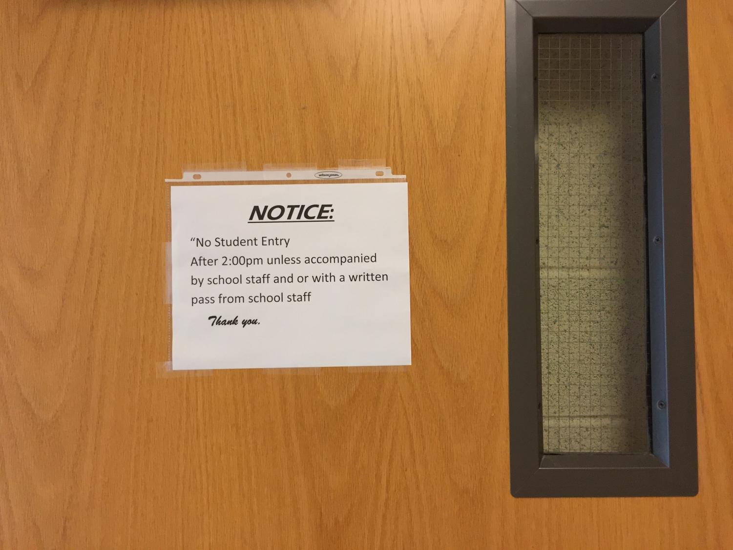 The administration left signs on doors throughout the hallway concerning after school hallway activity.