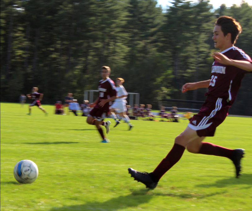 Donning+his+maroon+soccer+jersey%2C+sophomore+Nick+Haugen+sprints+down+the+field+at+a+home+game+against+Wachusett+on+September+27.