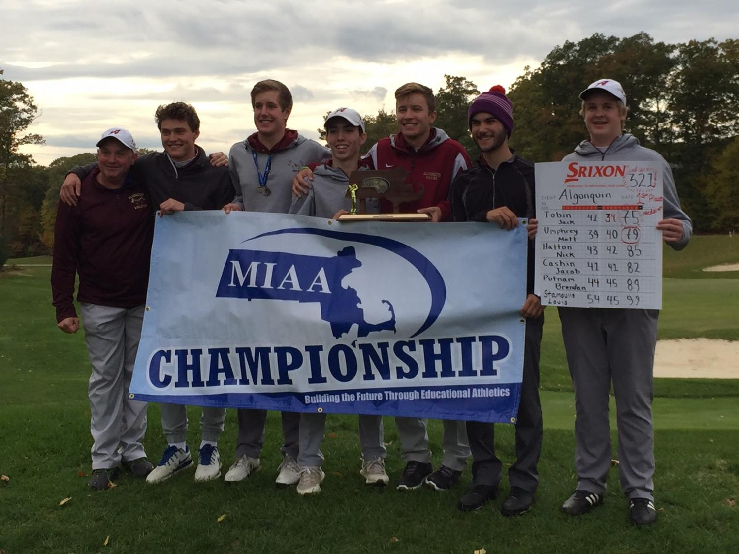 Coach Bob Cullen, seniors Matt Umphrey, Jack Tobin, and Nick Hatton, junior Brendan Putnam, senior Louis Stamoulis, and junior Jacob Cashin celebrate their District Championship win on Monday.