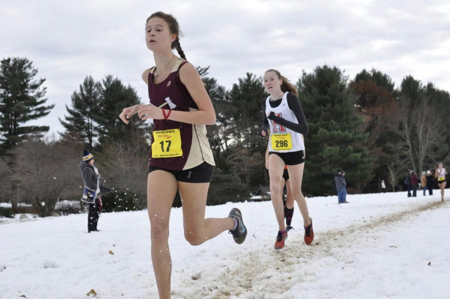 Junior+Julia+Kardos++runs+past+her+opponent+on+the+snowy+trail+at+Stanley+Park+for+the+All-State+meet+on+November+18.