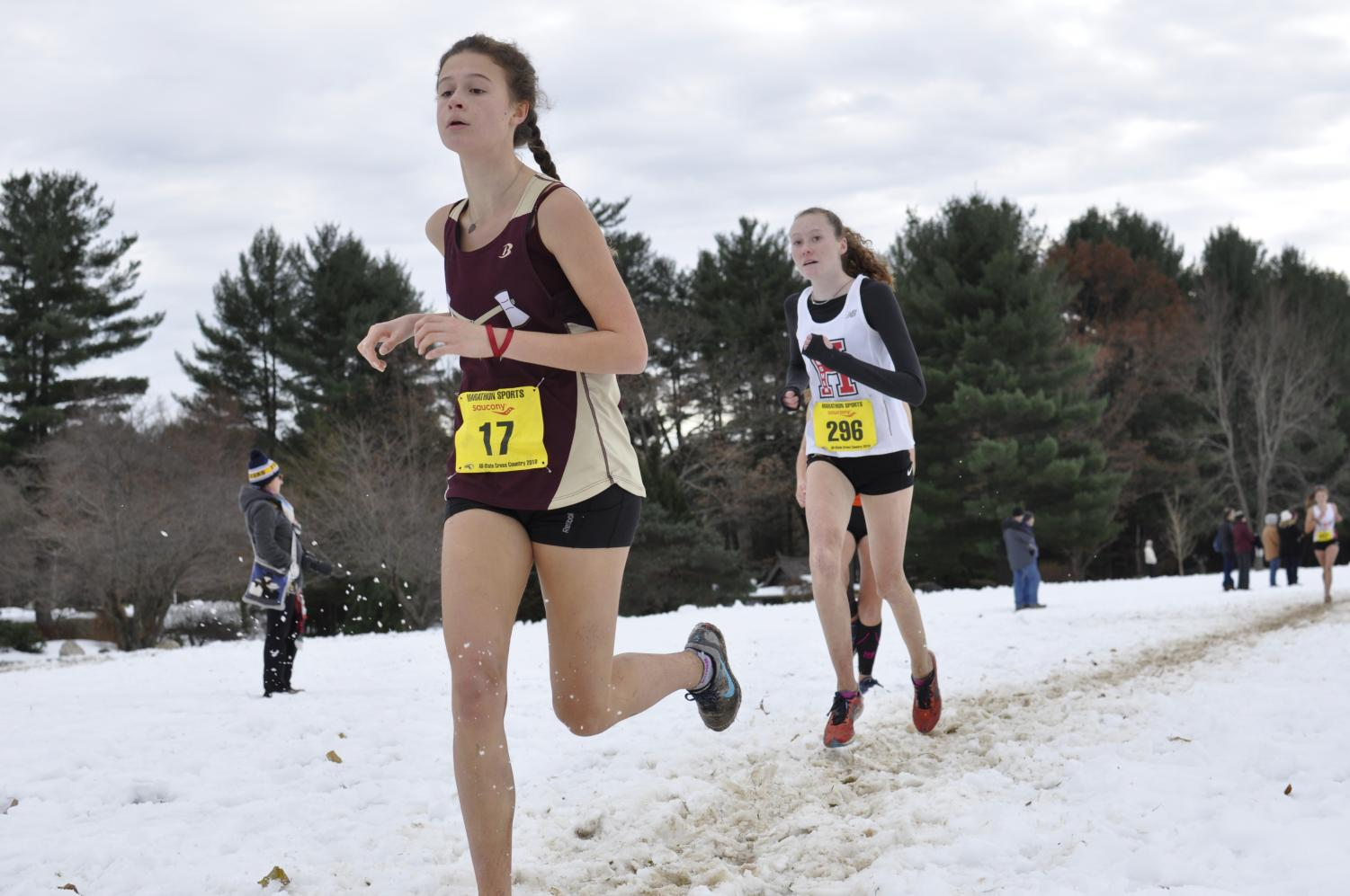 Junior Julia Kardos  runs past her opponent on the snowy trail at Stanley Park for the All-State meet on November 18.