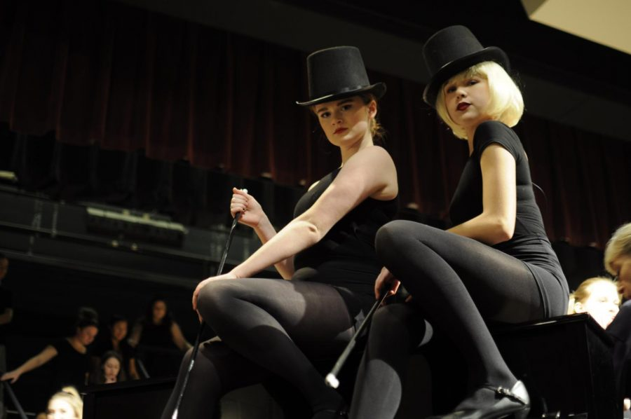 Sophomore Miranda Slingluff [left] and freshman Sarah Boush [right] serve fierce looks as they rehearse in costume for Chicago.