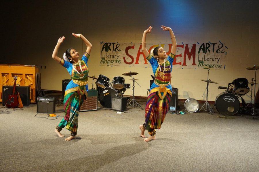 Seniors Priyanka Joshi and Rianna Mukherjee peform a traditional dance to the song Pushpanjali.