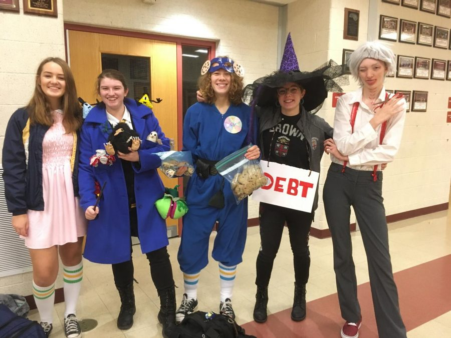 """""""Its a super hero that throws cookies with magic powers, sophomore Lucy Reuter [third from left] said. Each cookie does something different."""" [From left to right] German exchange student Zoé Fettke and sophomores  Sarah Cassidy, Reuter, Lainey Bechta, Maxwell Vere all pose together in their spirited costumes."""