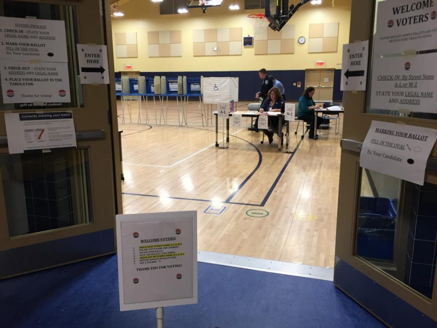 After 13 hours of hard work, election workers finish up paperwork to conclude voting in Northborough's 2nd precinct.