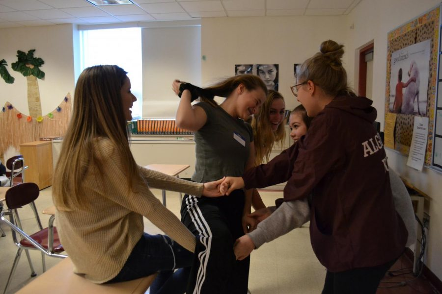 Freshman girls laugh as they work together to complete a friendship building game hosted by English teacher Kathleen Clark.