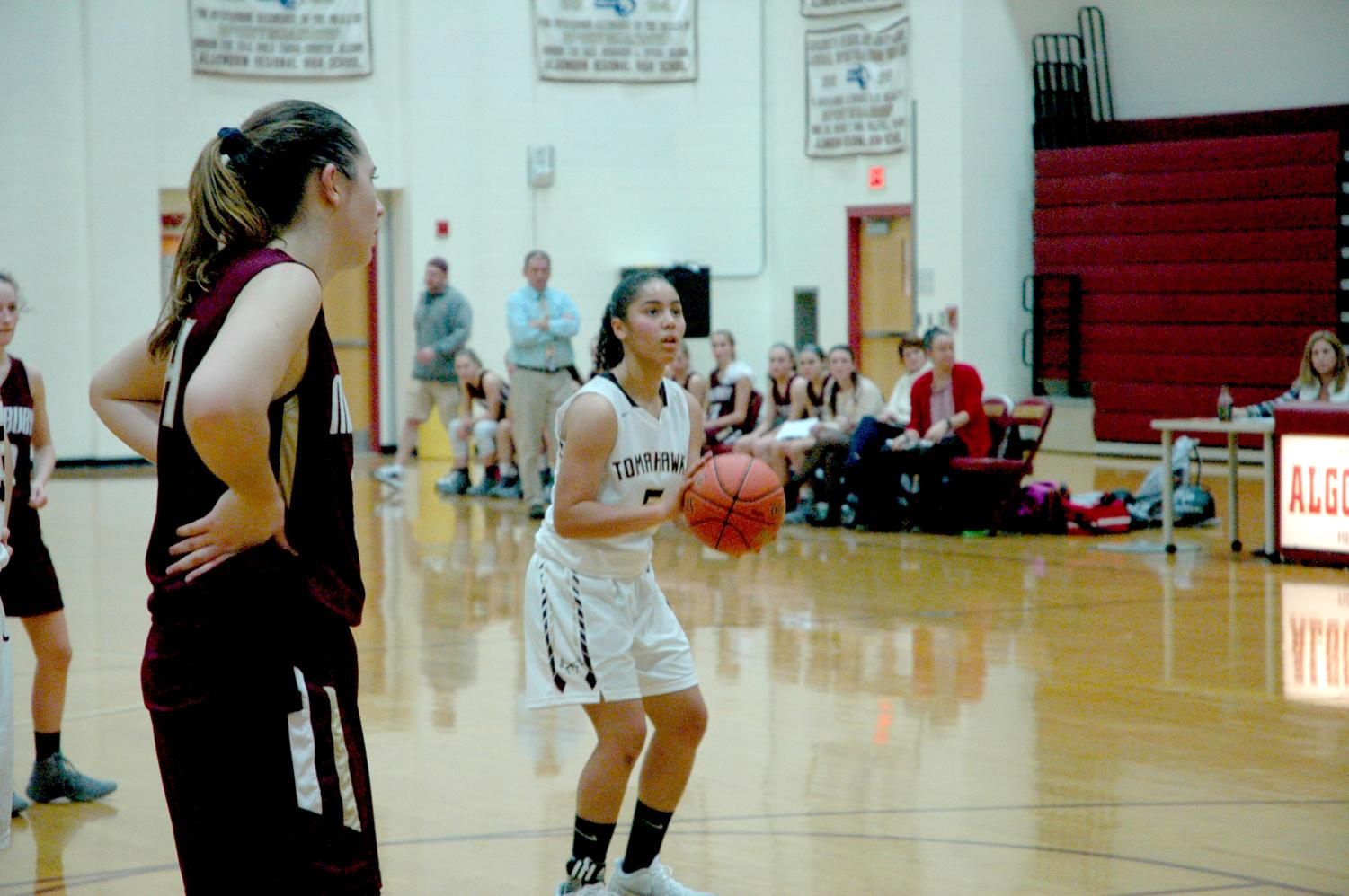 Senior Naraylee Baez prepares to take a free throw. Baez led the T-Hawks in scoring with 10 points.