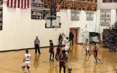 Karaban leads boys' basketball to victory in season home opener against Doherty Highlanders