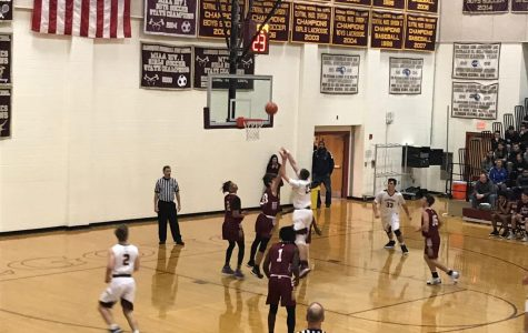 Karaban leads boys' basketball to victory in season home opener against Doherty Highlanders