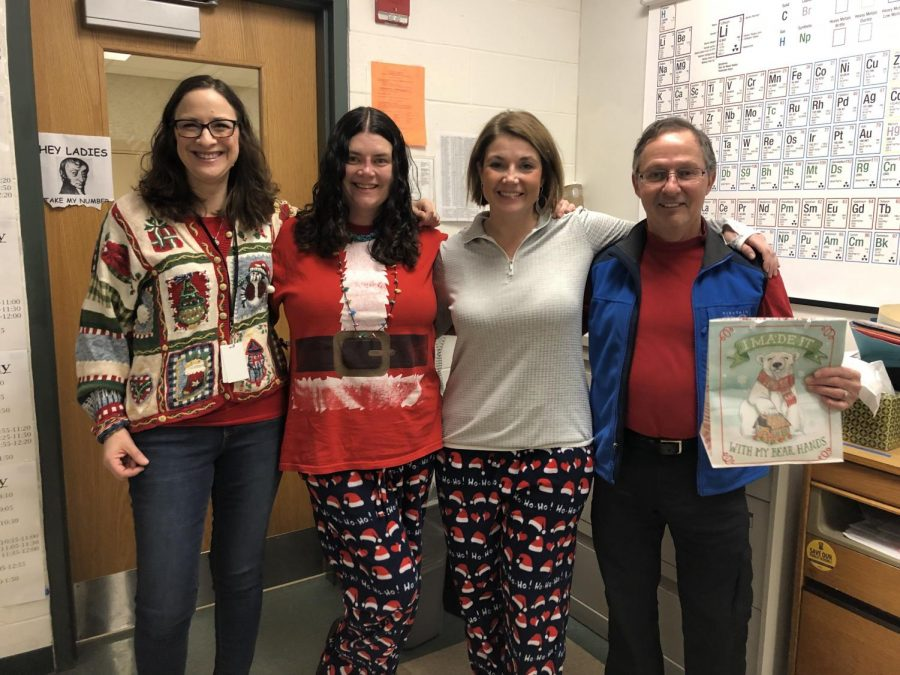 [From left to right] Science teacher Christine Burchat, guidance counselor Pamela Mackey, guidance counselor Andrea Hotchkin and science teacher Kenneth Wieder pose in their holiday gear.