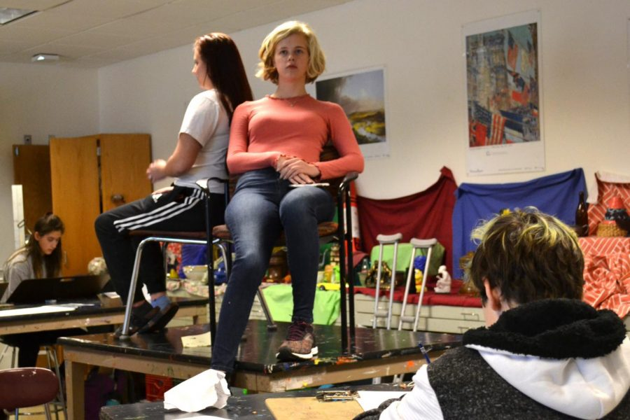 Bystanders in the hallway did a double take as they witnessed senior Emily Dietz and junior Elizabeth Webb posing for a class of portrait artists in art teacher George Hancin's STEP.