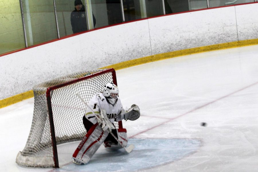 Algonquin freshman goalie Lana Pacific prepares to block a shot from Ursulines forwards. She blocked all but one of 21 shots on goal.