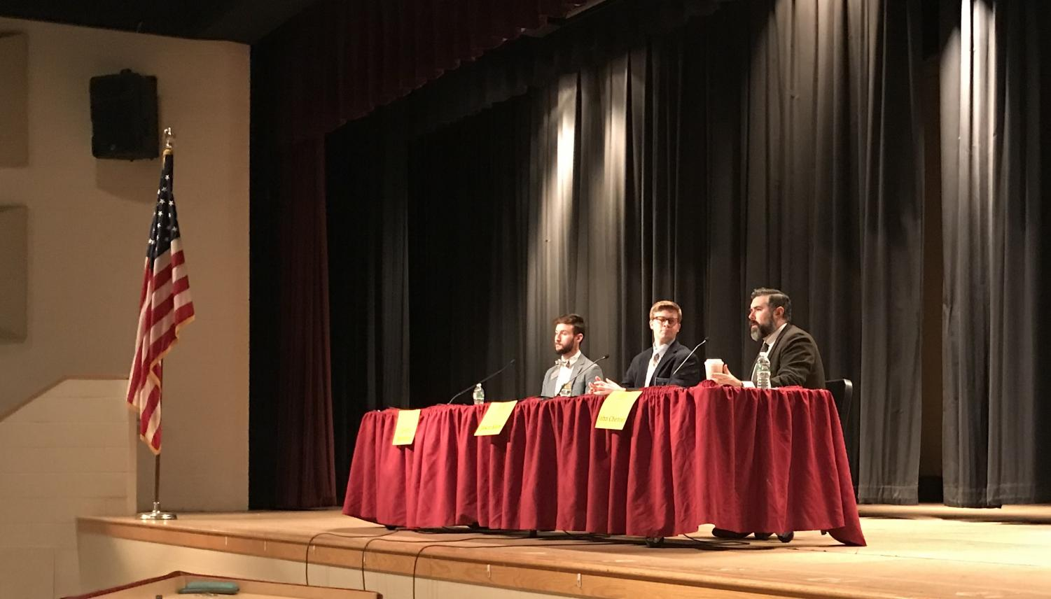 Assistant Dean of Admissions at Framingham State University John Chenier [right] responds to a student's question during a college panel for the junior class on January 31.