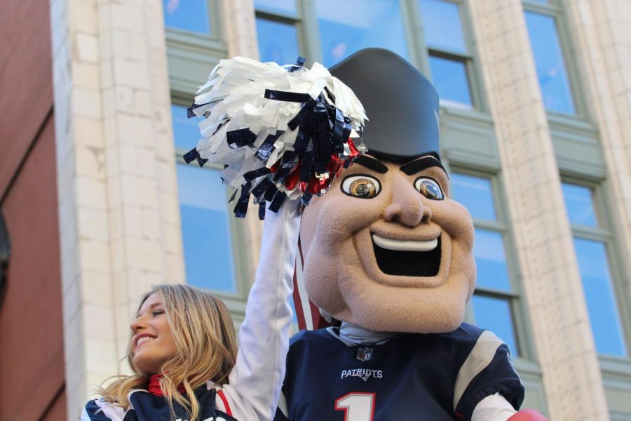Pat Patriot greeted fans on a float with the cheerleaders.