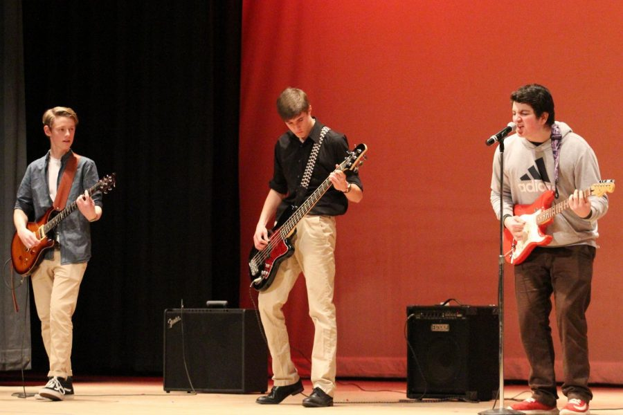 [Left to Right] juniors Ben MacNeil, sophomore AJ Ryan and junior Nick Loughlin rock the stage, playing a cover of Supersonic by Oasis with their band Hypothetical Moon Landing.