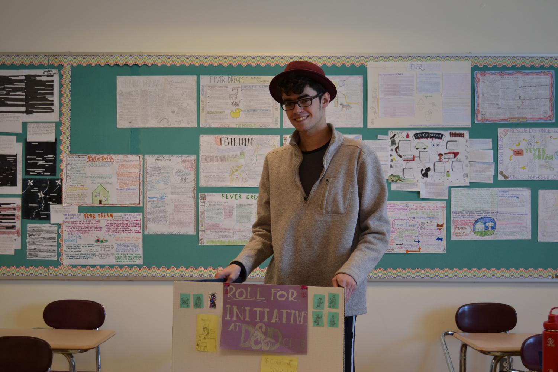 Senior Ryan Blight demonstrates his poster for