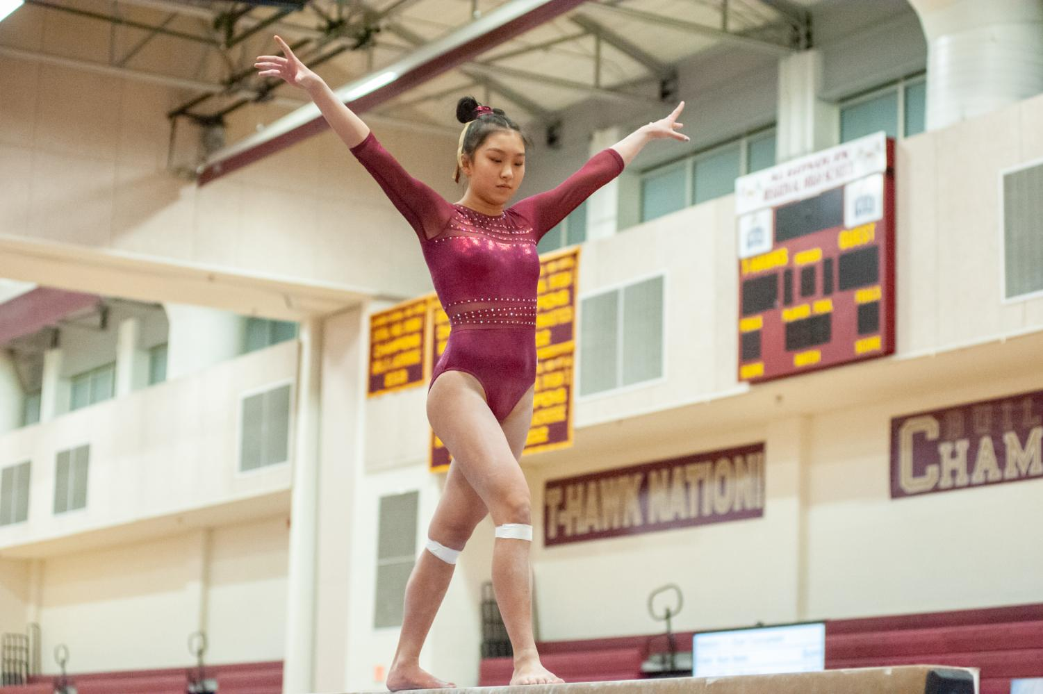 Junior Sequoia Truong performs her routine on the beam at States on March 2.