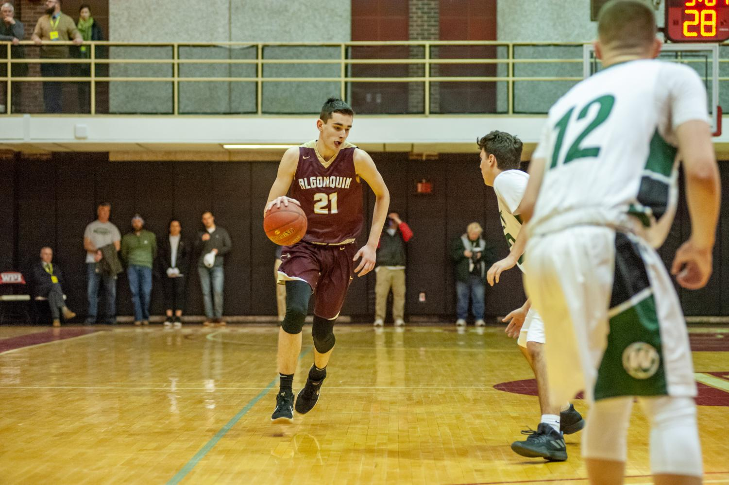 Freshman Alex Karaban had a standout performance during the district semi-finals where he scored 20 points at  Worcester Polytechnic Institute on March 3.