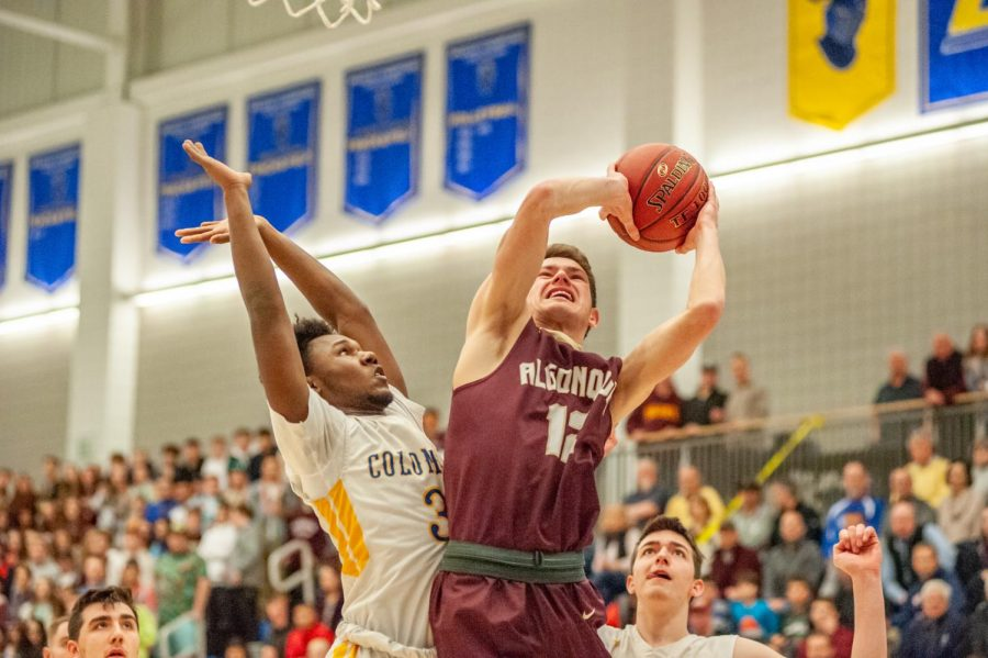 Senior captain Sean Cullen takes a shot at the the Division 1 Central Final against the Acton-Boxborough Colonials. Algonquin lost the game 53-41. Cullen ended the game with nine points.