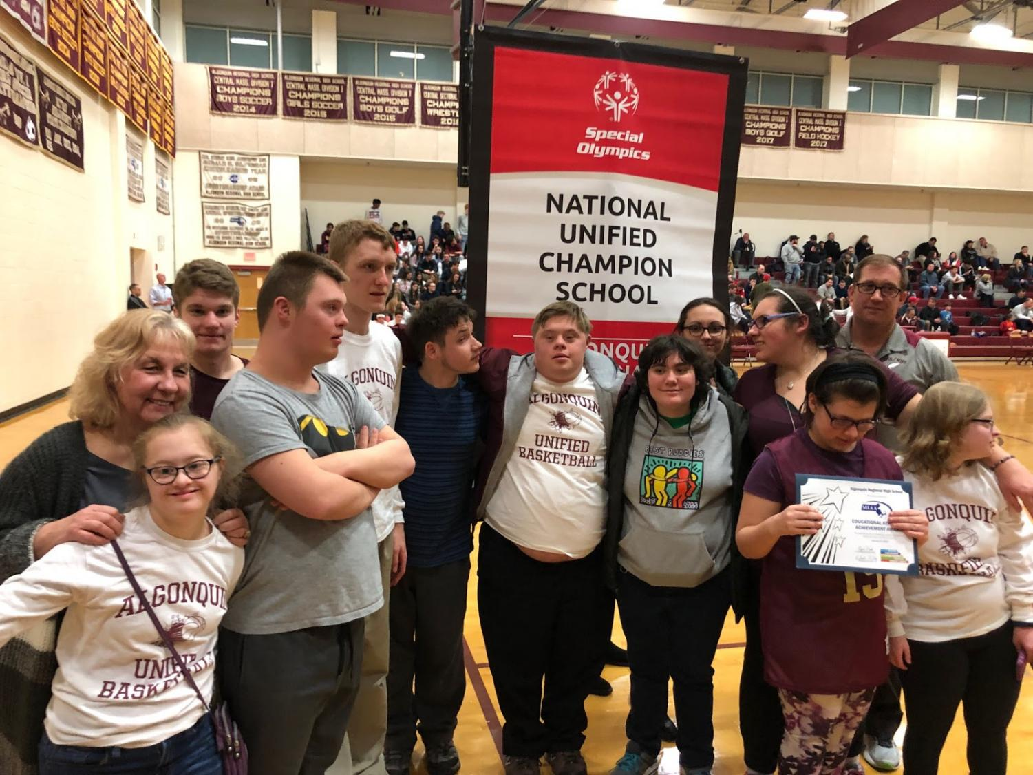 Members of the unified basketball and unified track teams celebrate awards recognizing inclusivity.