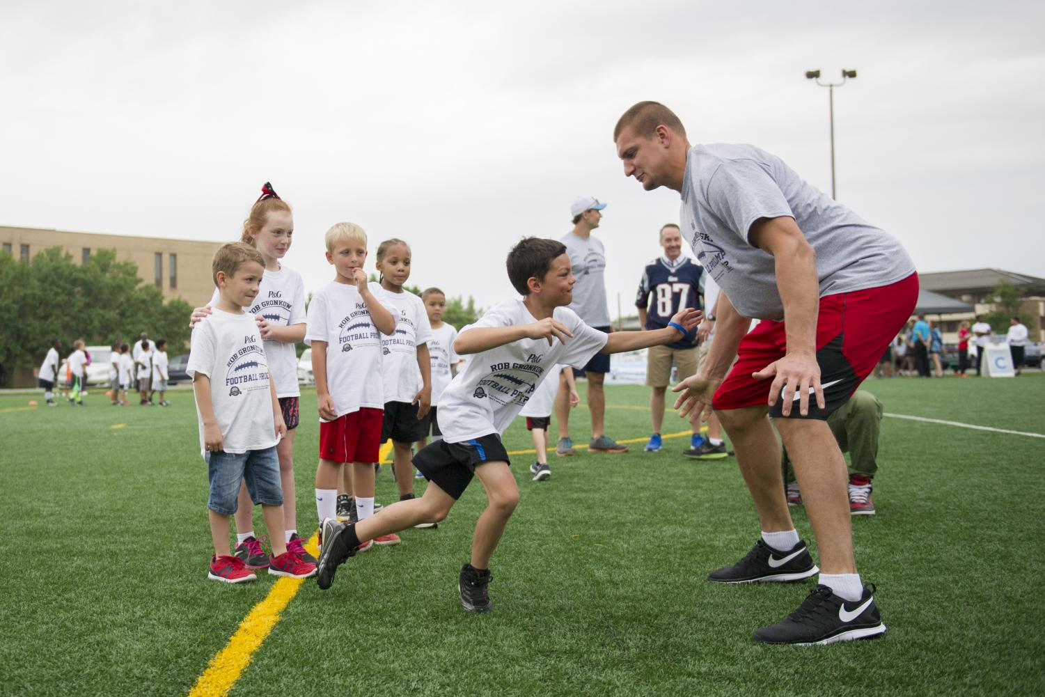 In addition to being a star player for the Patriots, tight end Rob Gronkowski gave back to his community. Gronkowski ran football drills for about 100 military children at a ProCamps event on Joint Base Andrews, Md., July 2, 2015.