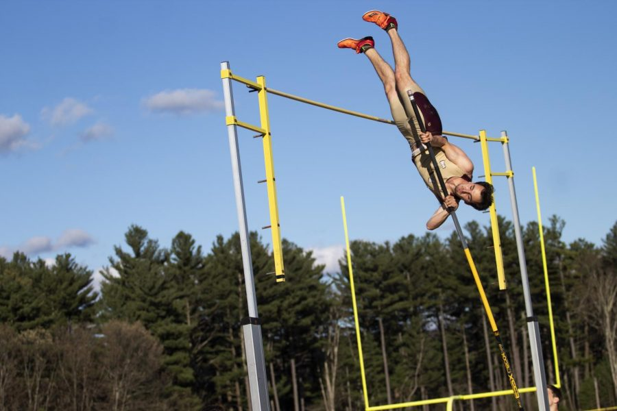 Senior+John+Bai+propels+himself+over+the+bar+in+pole+vault.+Bai+cleared%2C+placing+first+in+the+meet+with+a+12+6+jump.