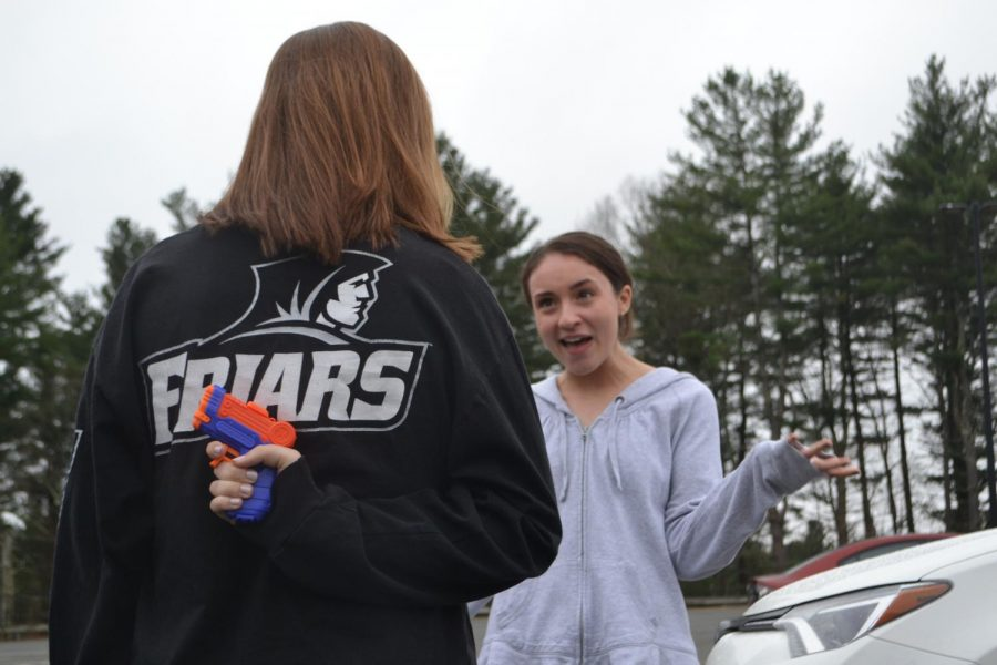 Senior Lauren Early prepares to get her target, senior Olivia Reilly.