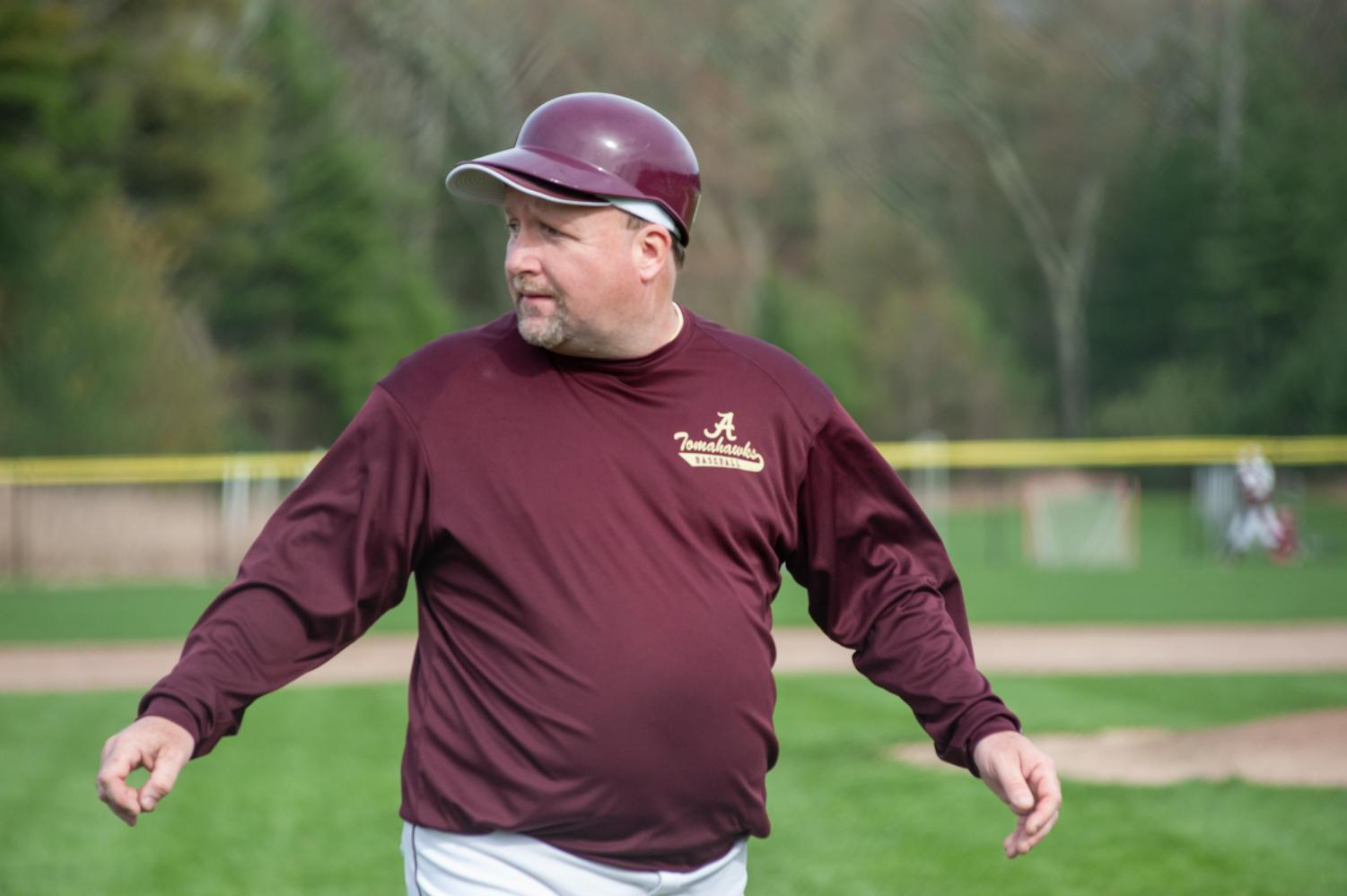 As the inning closes in the game against Marlborough on April 29, new baseball varsity coach Brian Doherty looks back to praise one of his players.
