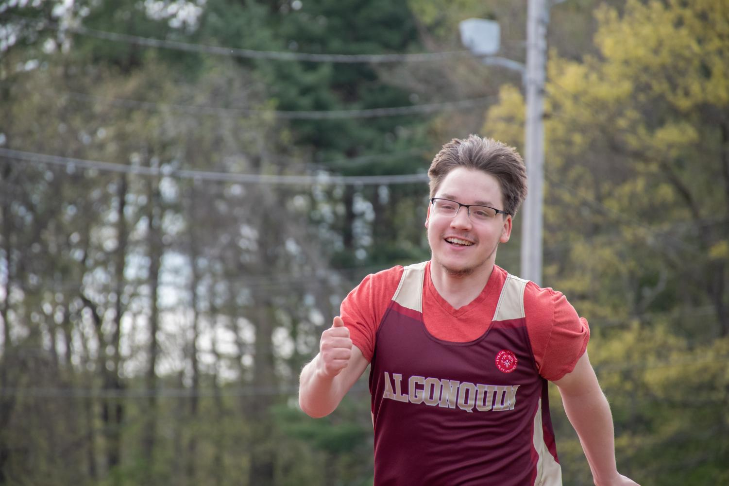 Senior Nick Vaskas runs along the track in the unified track meet against Westborough.