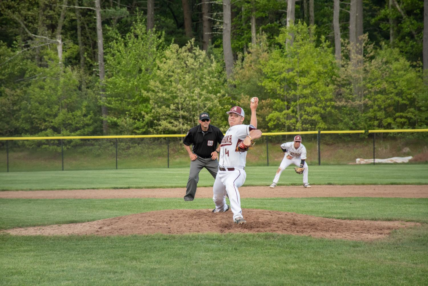 Sophomore Sam Hill delivers a pitch against Shrewsbury. The team suffered a 12-3 loss to Shrewsbury on May 20.