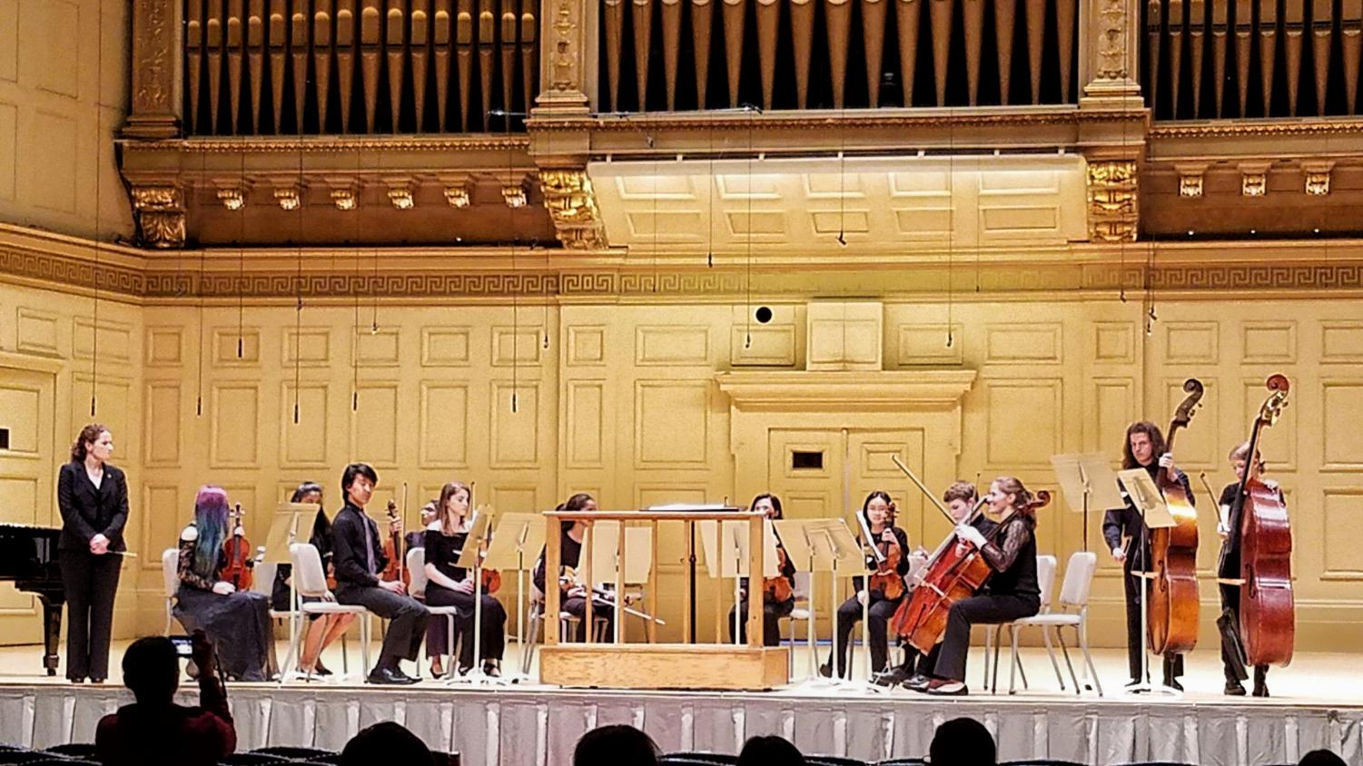 The string orchestra performing at Symphony Hall in Boston on May 4 after receiving a gold medal at the MICCA festival in April.