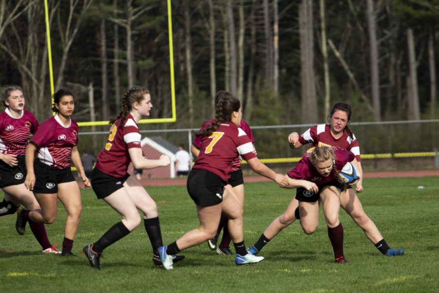 Freshman Colleen Mulligan avoids being tackled in a game against Weymouth.  Mulligan is one of the new players on the team this year that is learning the rules as she goes.