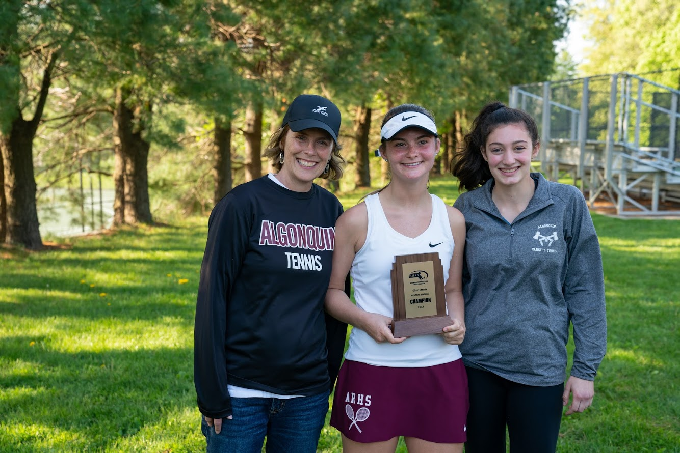 Freshman Olivia Almy [center] poses with her coaches Julie Doyle and Talia Gilfix after she won the Central Massachusetts girls' tennis singles title.
