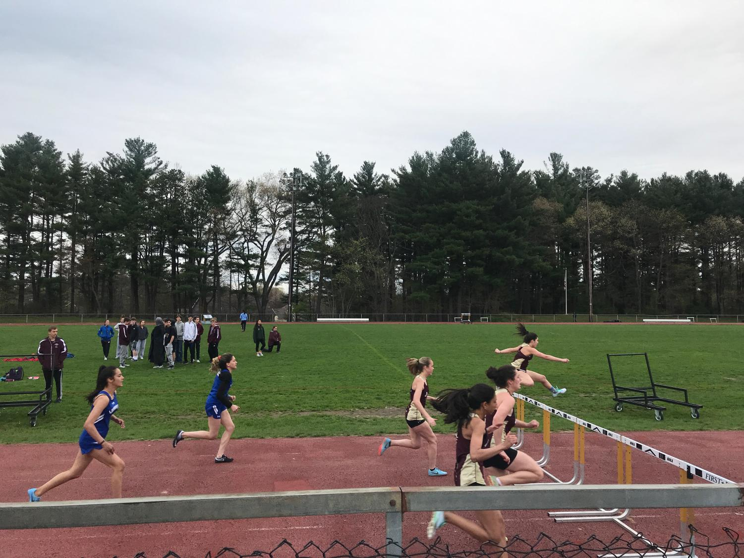 Algonquin athletes dominate Leominster in the 400M hurdle event, claiming all three top spots.