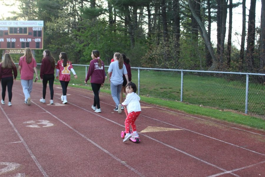 A+group+of+girls+walk+on+the+track.+During+the+course+of+the+night%2C+one+person+from+every+team+must+be+walking+the+track+to+symbolize+the+journey+people+go+through+when+having+cancer.