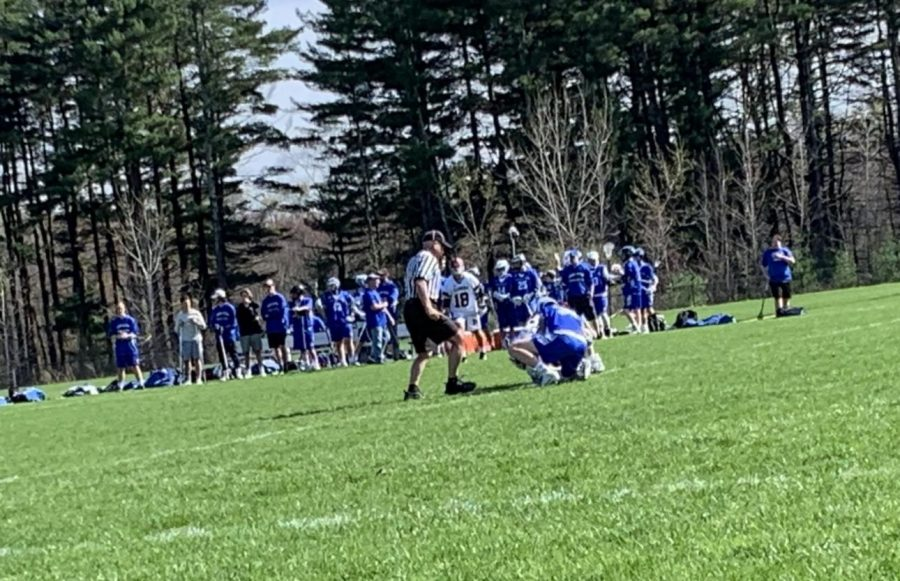 Freshman Graham Ray starts the game with the face off against Leominster.