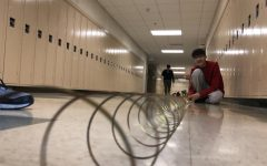 SLIDESHOW: Physics classes use Slinkys to learn about wave behaviors