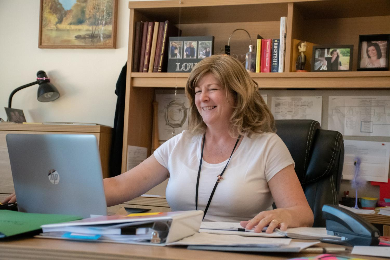 Assistant Principal Michele Tontodonato works at her computer as the school year wraps up. She will be assuming a position as Director of Finance and Operations at a different school on July 1.