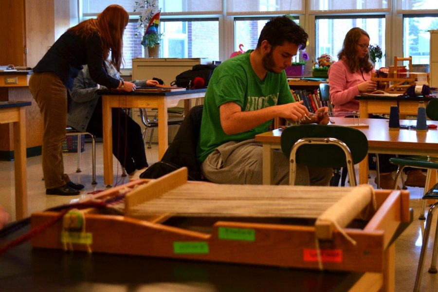 Sophomore Matthew Semmel and junior Kaley Somers participate in an introduction to weaving STEP block.