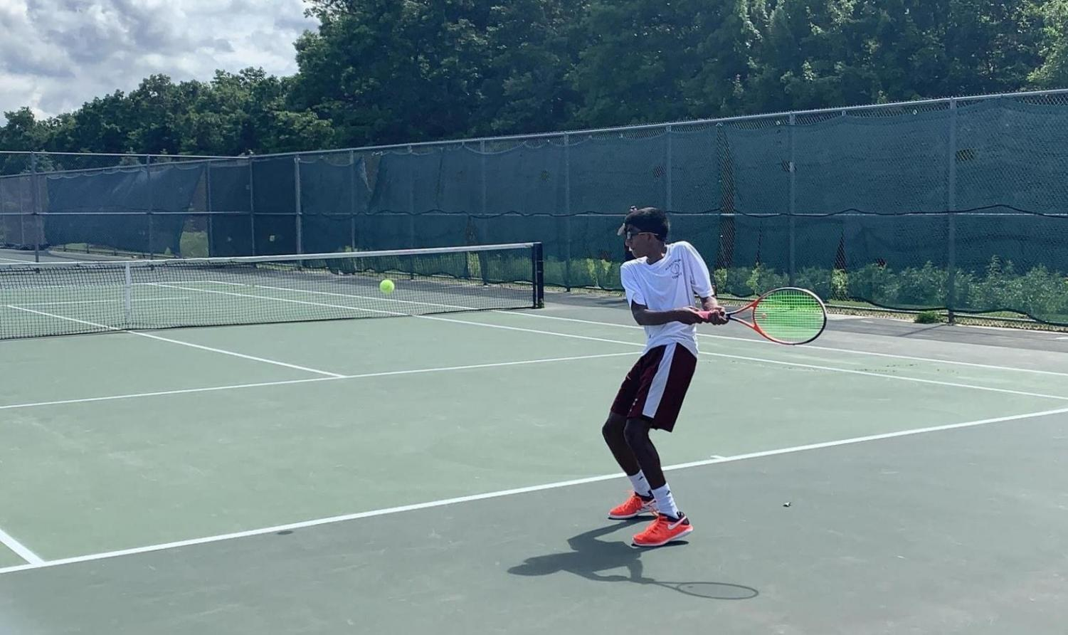 Sophomore and third singles player Bharathan Sundar prepares to hit a backhand in the state finals match.
