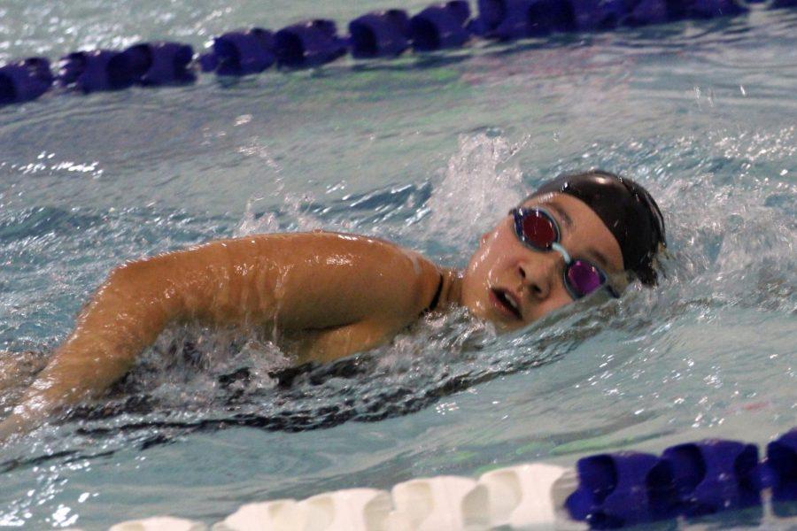 Sophomore Hikari Torikai swims freestyle at her meet on Jan. 18.