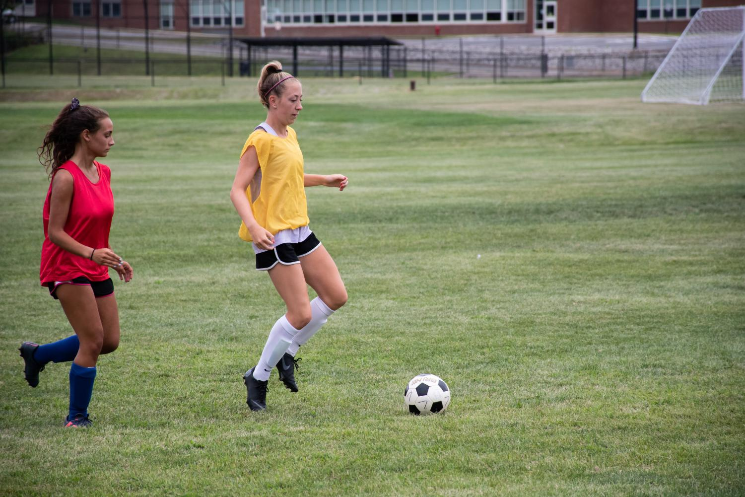 Senior+Megan+Keller+looks+to+control+the+ball+and+move+it+past+her+defender+to+advance+up+the+field.