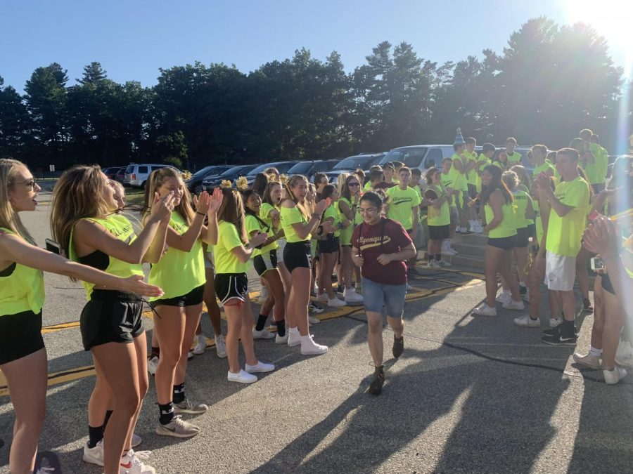 The gauntlet is an annual tradition where upperclassmen mentors cheer as freshmen enter the building.