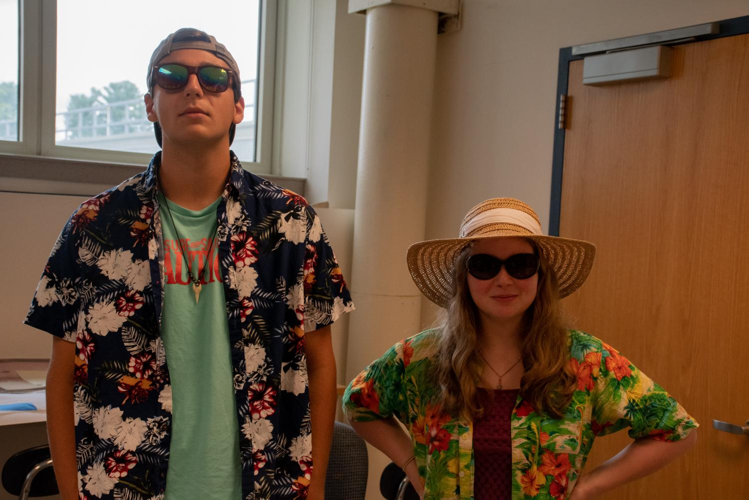 Wearing+their+flamboyant+%22Hawaiian+style%22+shirts%2C+seniors+Kaley+Somers+and+Matt+Rawlings+proudly+participate+in+beach+day.+%E2%80%9C%5BSpirit+week%5D+builds+a+community+between+peers%2C+and+they+are+fun+to+do%2C%22+Somers+said.