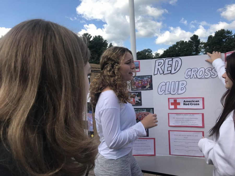 Senior Izabelle Medynski watches as junior and Red Cross member Isabelle Shakespeare talks to a potential club member. Red Cross meets every Tuesday in B122.