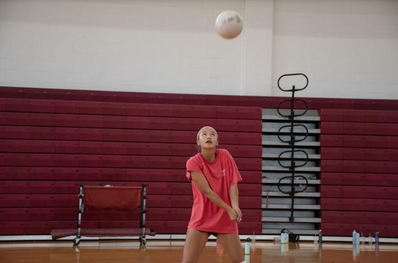 Junior+Yasmin+Lee+bumps+the+ball+into+the+air.