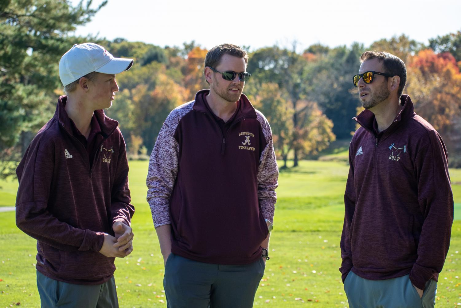 New coaches Mike Groccia (right) and Brian Calnan (middle) discuss the upcoming match against Leominster with teeam captian senior Kevin Henderson (left).