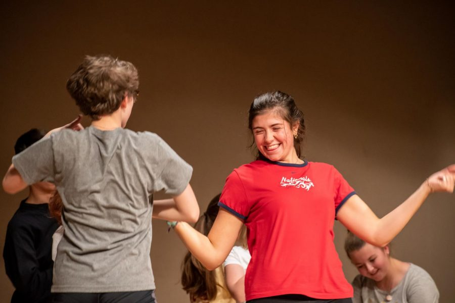 Senior Bella Estes gets in the groove while rehearsing the play.